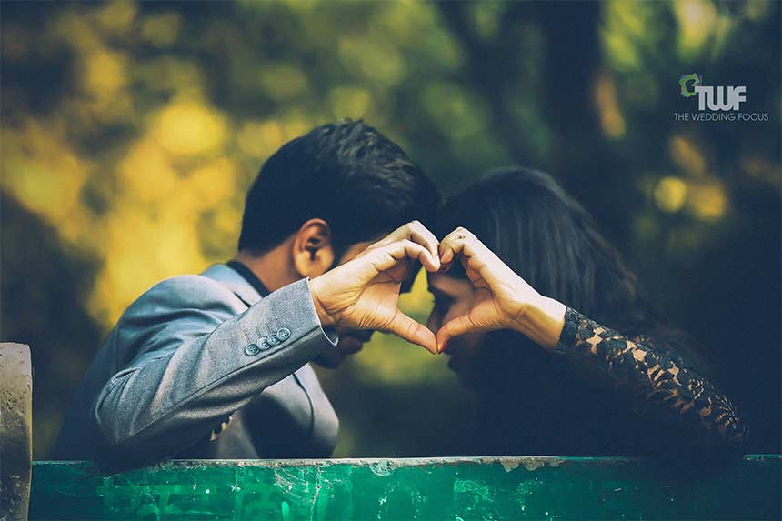 Hands Making Love Symbol by Couple Pre Wedding Shoot